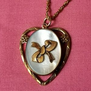 Vintage gold filled locket bow and mother of pearl